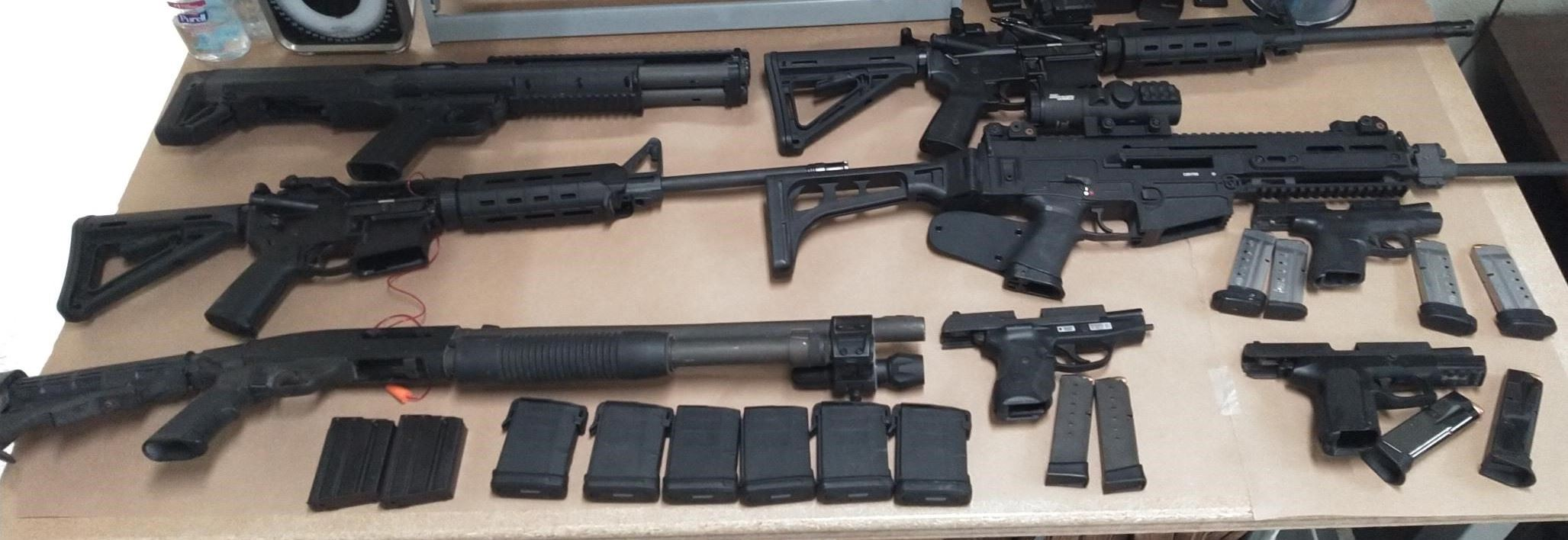 Eight black firearms located during search warrant