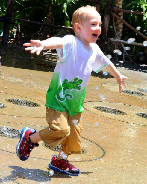 young boy enjoying the water park